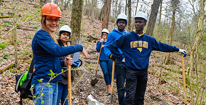 Professor Vaike Haas with her class doing trail work.